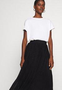 Anna Field - Plisse mesh mini skirt - Áčková sukně - black - 3