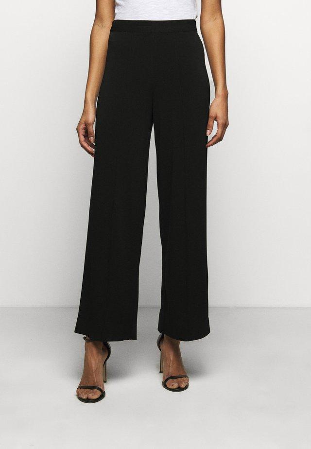 MIELA - Trousers - black