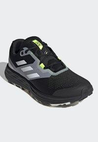 adidas Performance - TERREX TWO FLOW - Stabilty running shoes - savannah/core black/hi-res yellow - 2