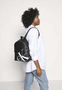 Calvin Klein Jeans - ROUNDED  - Rucksack - black - 1