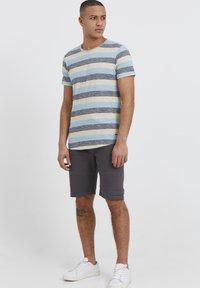 Solid - RUNDHALSSHIRT THICCO - Print T-shirt - light blue - 1