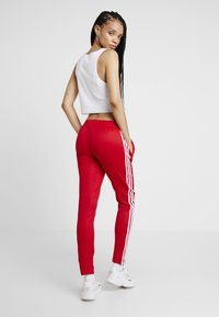 adidas Originals - Tracksuit bottoms - scarlet - 2