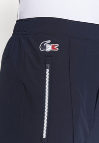 Lacoste Sport - OLYMP PANT - Trousers - navy blue/white - 4