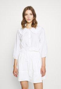 Monki - MILDA BLOUSE - Button-down blouse - white - 0
