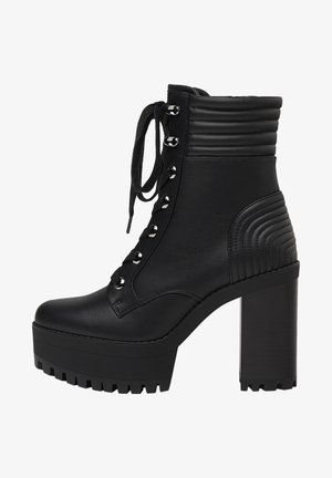 MIT ABSATZ UND STEPPMUSTER  - High heeled ankle boots - black