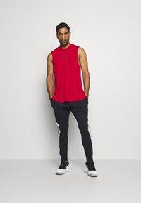 Jordan - AIR DRY PANT - Pantalones deportivos - black/white - 1