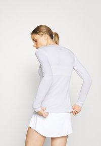 BIDI BADU - PIA TECH ROUNDNECK LONGSLEEVE - Sports shirt - white - 2