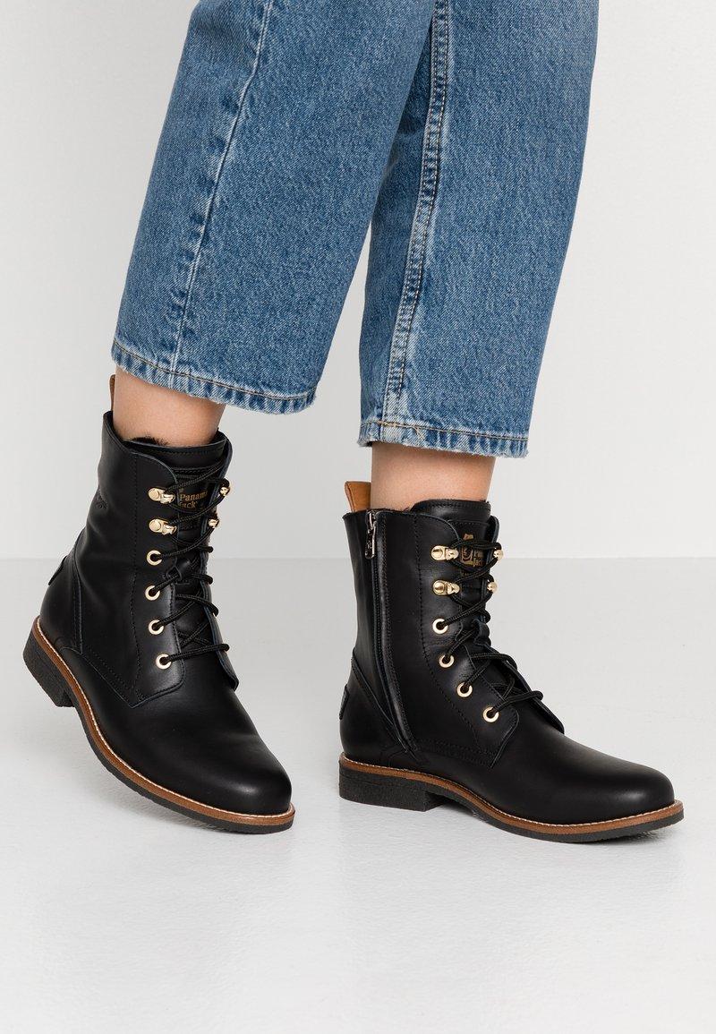 Panama Jack - GATHA IGLOO TRAVELLING - Lace-up ankle boots - black