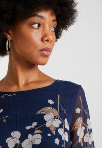 Vero Moda - VMCARINA BELT SHORT DRESS - Day dress - black iris/gabby - 3