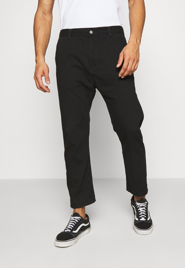 UNIVERSE PANT CROPPED - Relaxed fit -farkut - black