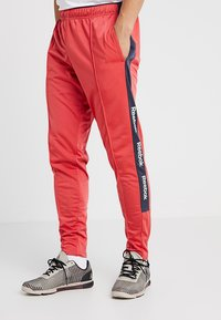 Reebok - TRAINING ESSENTIALS TRACK PANTS - Tracksuit bottoms - red - 0