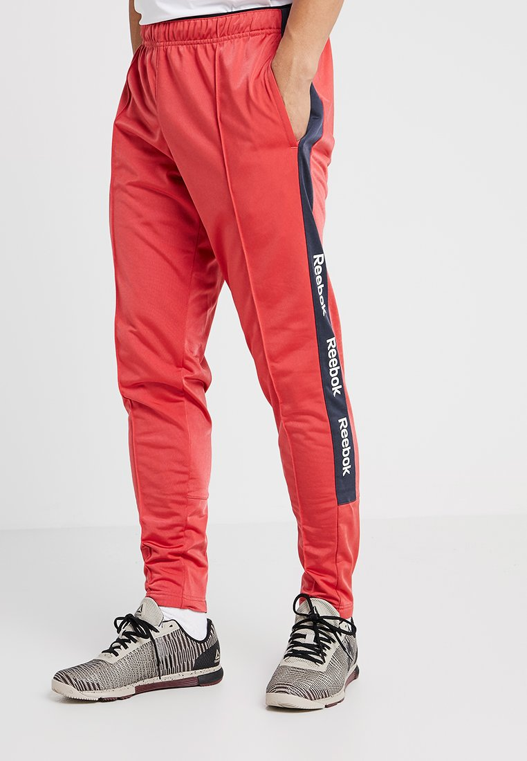 Reebok - TRAINING ESSENTIALS TRACK PANTS - Tracksuit bottoms - red