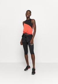 ASICS - TOKYO TANK - Sports shirt - performance black/flash coral - 1