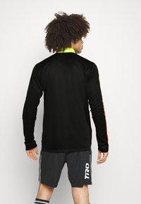 adidas Performance - TIRO - Veste de survêtement - black/red - 2