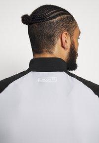 Lacoste Sport - TRACKSUIT - Träningsset - calluna/black/white - 6
