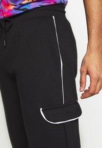 Urban Threads - Pantalones deportivos - black - 4