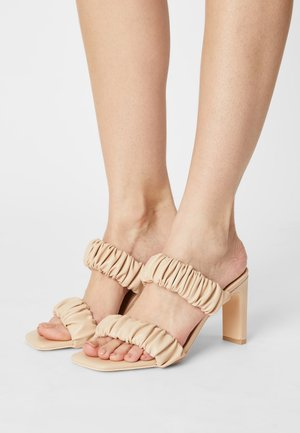 LOST ON YOU - Heeled mules - beige