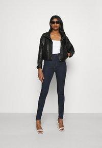 Levi's® - MILE HIGH SUPER SKINNY - Jeans Skinny Fit - blue denim - 1