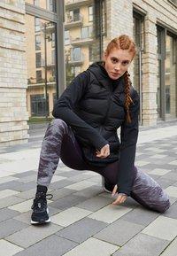 adidas Performance - HELIONIC DOWN VEST - Kamizelka - black - 4