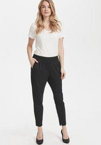 Cream - ANETT PANTS - Trousers - pitch black - 1