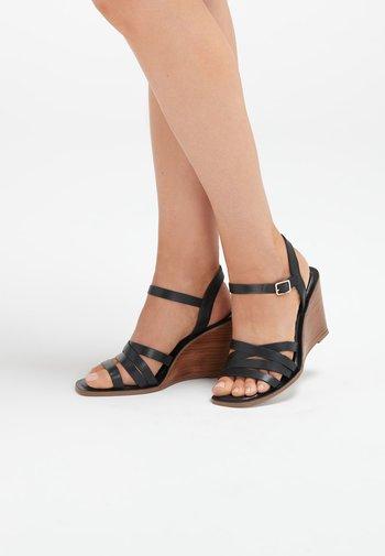 TAN STRAPPY WOOD HEEL WEDGES - High heeled sandals - black