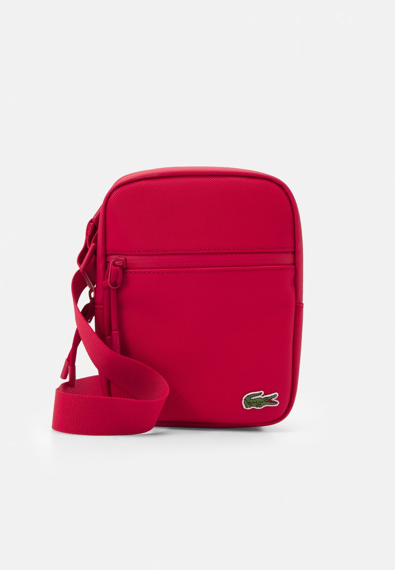 Lacoste - FLAT CROSSOVER BAG - Across body bag - rouge