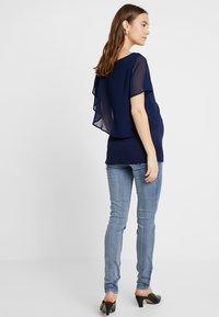 MAMALICIOUS - MLGOLDEN - Slim fit jeans - light blue denim - 2