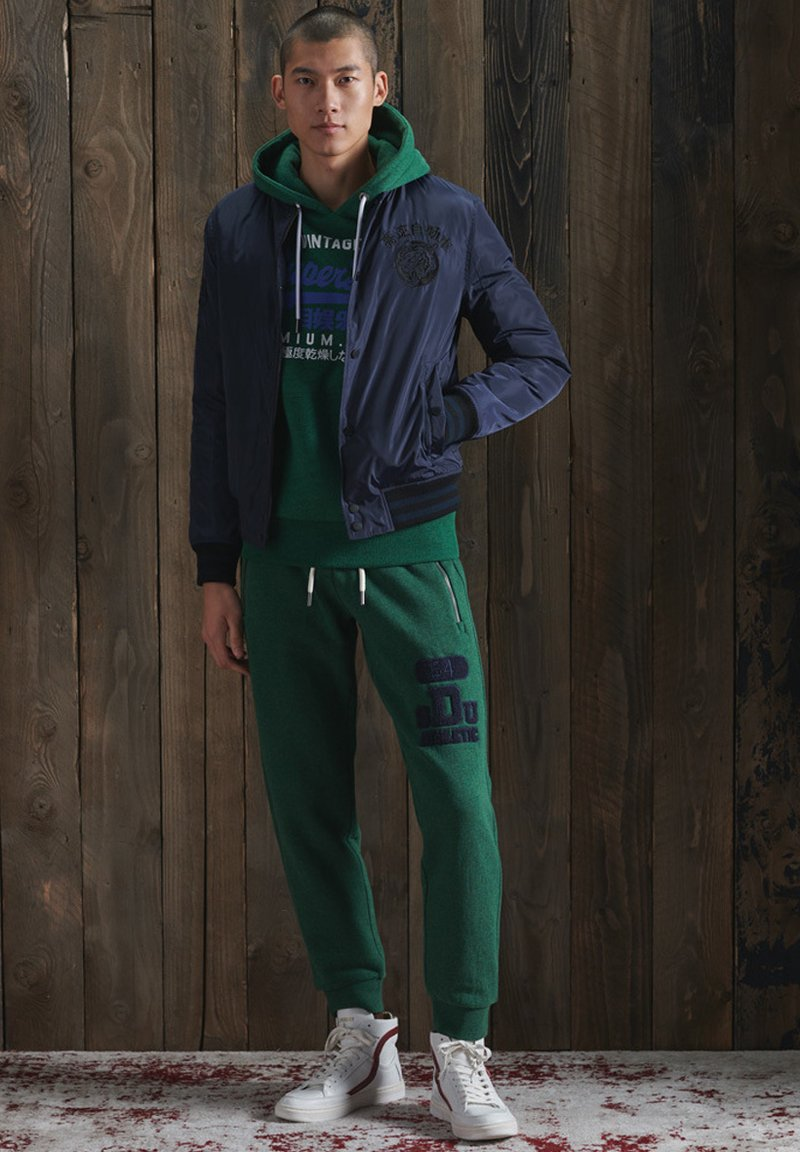 Superdry - Tracksuit bottoms - willow green grit