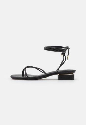 GIANNAFLEX - Flip Flops - black