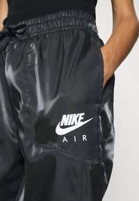 Nike Sportswear - AIR PANT SHEEN - Trainingsbroek - black/white - 4