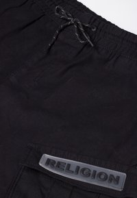 Religion - DAMAGE - Shorts - black