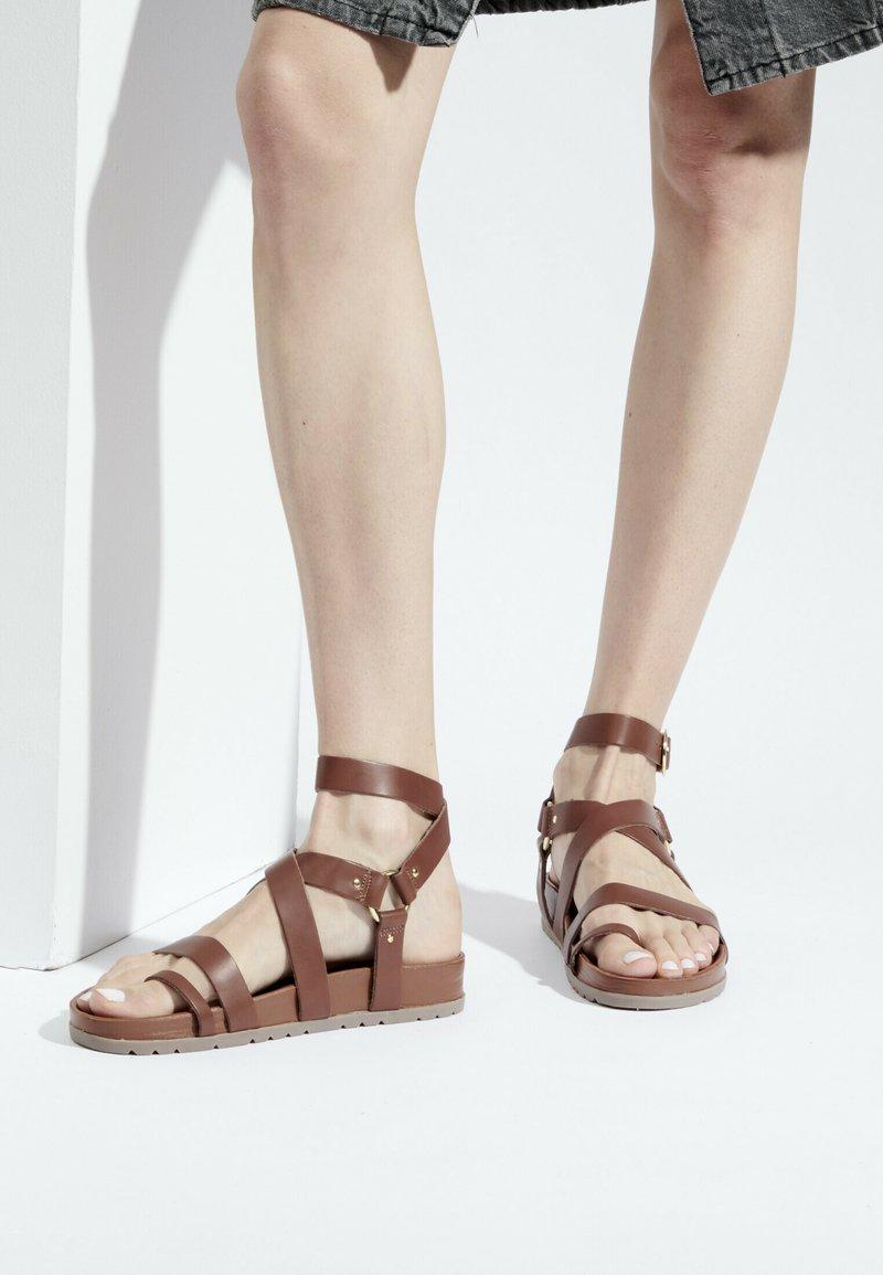 White Sun - OHANZEE  - T-bar sandals - tan