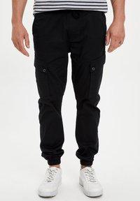 DeFacto - Cargo trousers - black - 0
