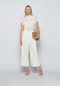BOSS - Trousers - natural - 1