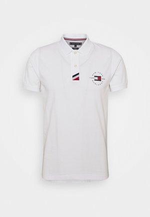 PLACKET SLIM - Polo shirt - white
