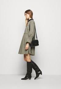 Mykke Hofmann - Day dress - dust green - 1