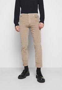 HUGO - Trousers - light pastel brown - 0