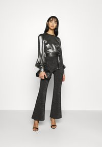 ONLY - ONLPAIGE FLARED GLITTER PANT - Trousers - black - 1