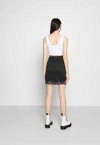 Vila - VIJASMIN FESTIVAL SKIRT - Mini skirt - black - 2