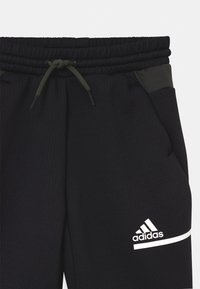adidas Performance - UNISEX - Tracksuit bottoms - black/legear/white - 2