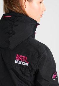 Superdry - TECH HOOD POP ZIP WINDCHEATER - Summer jacket - black/raspberry - 4