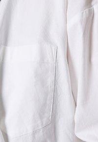 Monki - MEJA FANCY SHIRT - Button-down blouse - white solid - 5