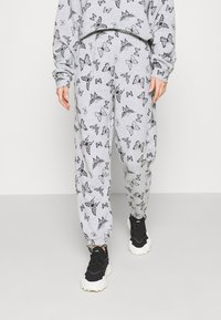 NEW girl ORDER - ACID BUTTERFLY JOGGER - Tracksuit bottoms - grey - 0
