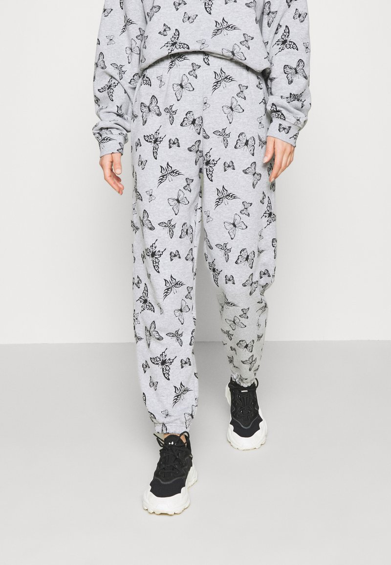 NEW girl ORDER - ACID BUTTERFLY JOGGER - Tracksuit bottoms - grey