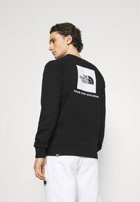 The North Face - RAGLAN REDBOX CREW NEW  - Sweatshirt - black/white - 0