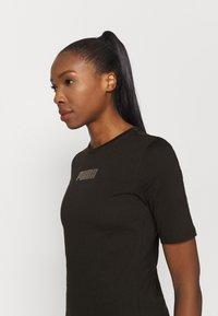 Puma - MODERN BASICS TEE - Print T-shirt - black - 3