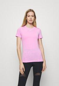 Nike Performance - ALL OVER - Basic T-shirt - beyond pink - 0