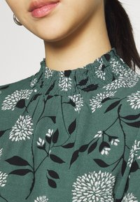 ONLY - ONLNOVA LUX SMOCK - Blouse - balsam green/white - 4