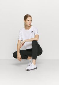 Champion - CUFF PANTS LEGACY - Trainingsbroek - black - 1