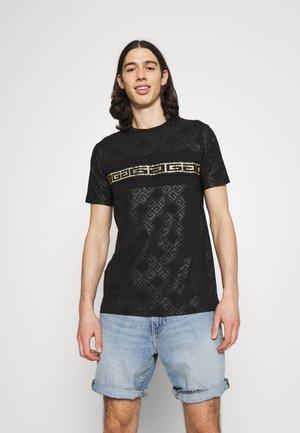 MINOS TEE - Print T-shirt - jet black/gold